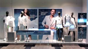 Promotional retail window signs